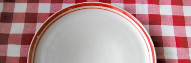Plate on checked cloth